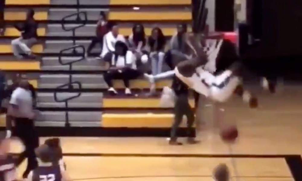 Ja'Quavion Boston-Gaines hangs on the rim after a dunk for LaFayette High in Alabama (Photo: @overtime/Twitter screen shot)