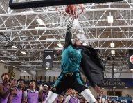 Fran Belibi dunks over two girls at Stanford women's basketball camp
