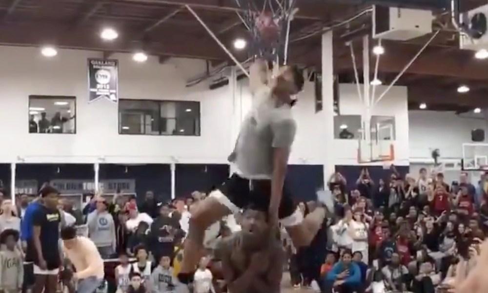 Dior Johnson dunks over an AAU teammate (Photo: @overtime/Twitter screen shot)