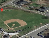 Another high school field was set on fire to try to dry infield dirt