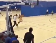 VIDEO: Watch a young basketball player get pushed by a parent in the stands