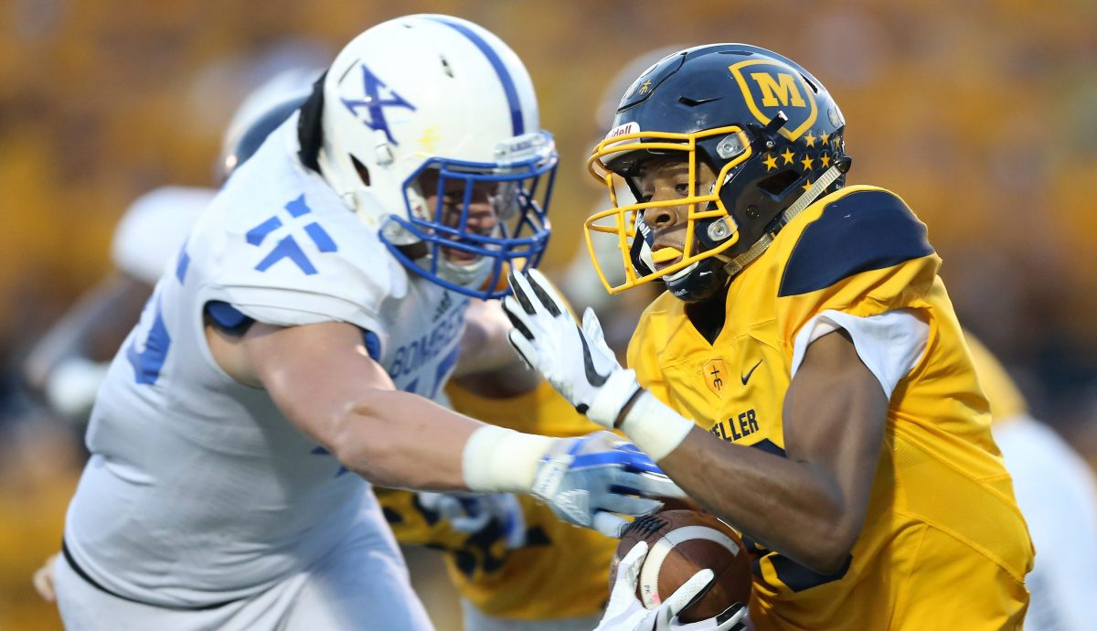 Moeller wide receiver Carrington Valentine (19) is tackled in the backfield