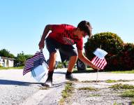 Florida high school football team plants 10,000 flags in community