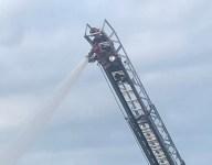 N.Y. high school athlete swaps football helmet for firefighter's to fight blaze