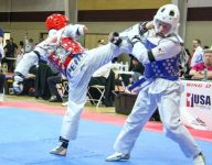 Born with one arm, 14-year-old black belt shoots for 2024 Paralympics