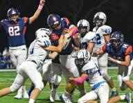 WATCH: Eighth-grader throws for over 500 yards, 6 TDs in second varsity start